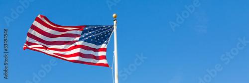 Fotografie, Obraz  Americká vlajka proti modré obloze