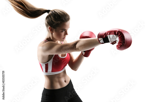 Keuken foto achterwand Vechtsport Boxer woman during boxing exercise making direct hit with glove