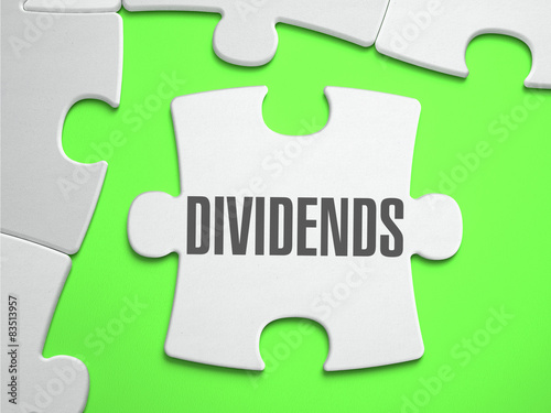 Fotografía  Dividends - Jigsaw Puzzle with Missing Pieces.