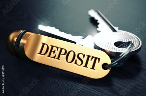Fotografía  Deposit written on Golden Keyring.