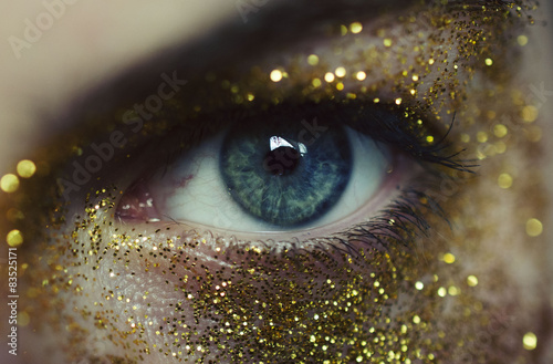 Poster  Close-up of woman eye with gold glitters