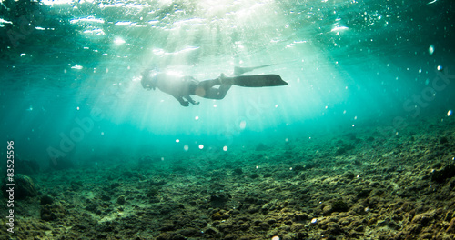 Person snorkeling in sea