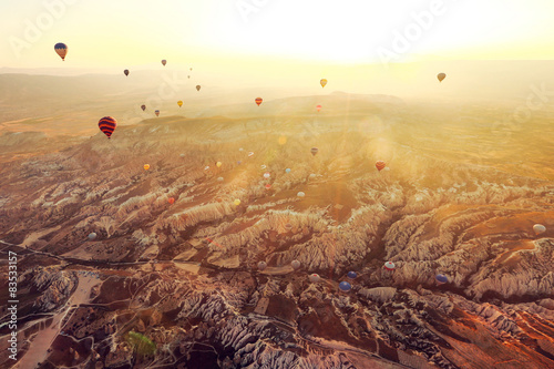 Aerial view of hot air balloons flying in sky