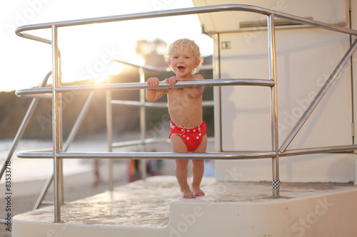 Toddler standing on lifeguard tower