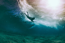 Duckdive Surfer And Sun Reflection Under Water