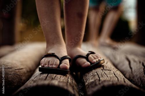 View of boy's feet in flip-flops
