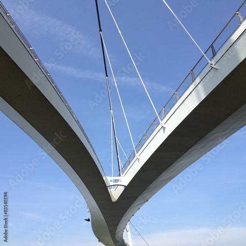 Keuken foto achterwand Bruggen Upward view of suspended bridge against blue sky