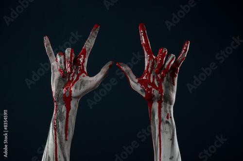 Fotografie, Obraz horrible zombie demon bloody hands on a black background