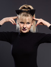 Young Beautiful Woman Dressed As Cuddly Cat Makes Gestures