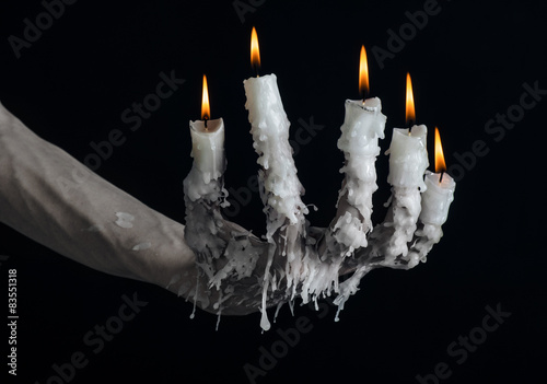 Fotografie, Obraz  on the hand wearing a candle and dripping melted wax studio