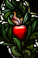 Naklejka Witraże sakralne A red heart in stained glass
