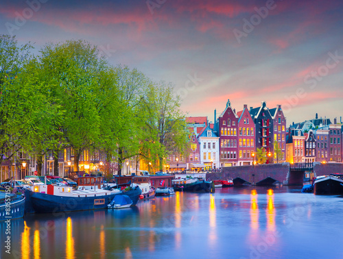 Photo Stands Amsterdam Colorful spring sunset on the canals of Amsterdam.