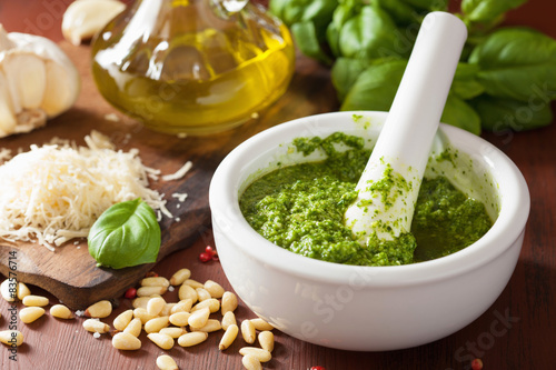 pesto sauce and ingredients over wooden rustic background Fototapeta