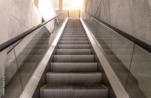 escalators stairway inside modern office building Wallpaper Mural