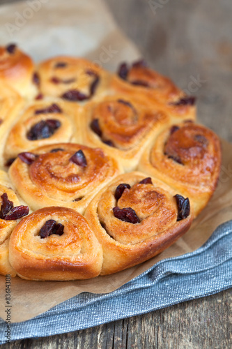 Photo  Traditional English buns Chelsea with dried cranberries