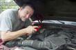 Mechanic Adding Oil To Older Truck