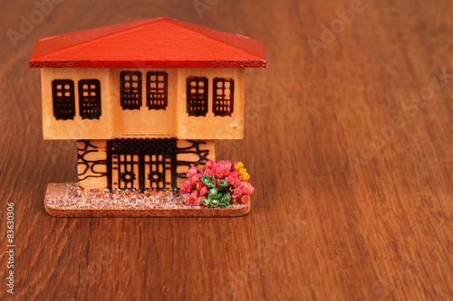 Photo  The miniature dollhouse on the wood