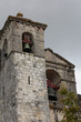 Medieval bell tower made of grey stone