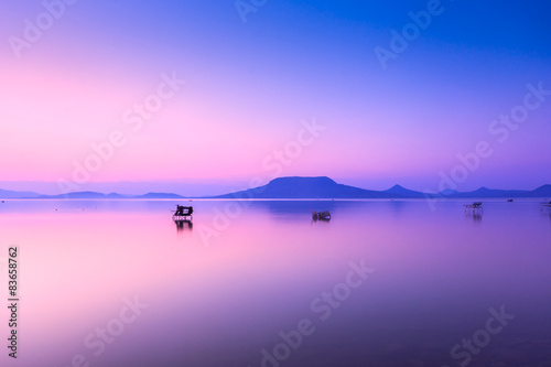 Tuinposter Purper Beautiful sunset in lake Balaton