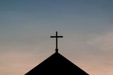 Silhouette Shot Of Single Cross On Church Over Blue Sky