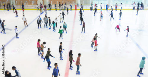 Canvas Print Defocused of indoor ice skating park with skating people.