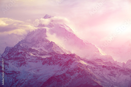 Photo Stands Light pink sunrise in the mountains