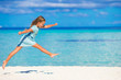 Adorable little girl running during beach vacation