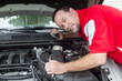 A Mechanic Putting Brake Fluid In A Customer's Car