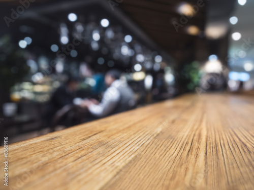 Láminas  Table top counter Bar restaurant background with people