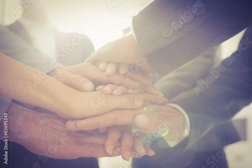 Fotografía  Business team standing hands together