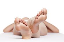 Well-groomed Female Feet On A White Sheet