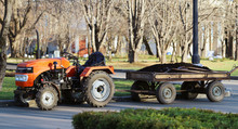 Orange Tractor With A Trailer ...