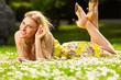 canvas print picture - Blondes Maedchen auf einer Blumenwiese