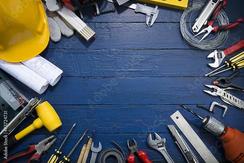 Foto op Aluminium Retro Construction Tools on Blue Wood