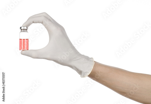 doctor's hand in a white glove holding a red vial of liquid Canvas Print