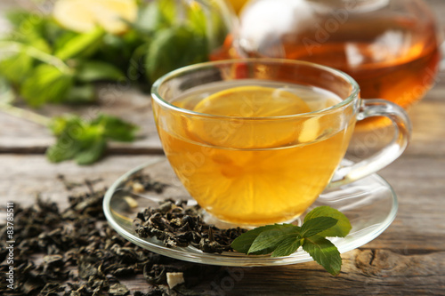 Recess Fitting Tea Cup with green tea on wooden background