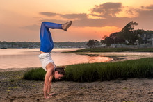Yoga Handstand On Beach At Sunset