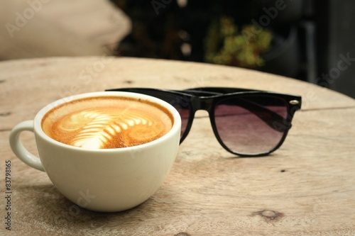Fotografie, Obraz  Coffee with sunglasses on background of wooden.