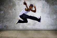 Hip Hop Dancer Jumping High On...