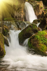 FototapetaBeautiful small waterfall landscape in the mountains.