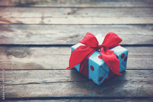 Fotografija  gift box on wooden table as natural background with copyspace