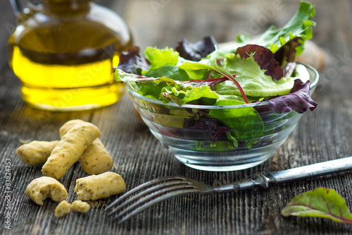 Fotografie, Obraz  Summer salad in a cup on a wooden background
