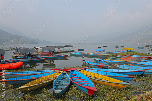 Foto op Canvas Nepal Boats on a lake in Asia
