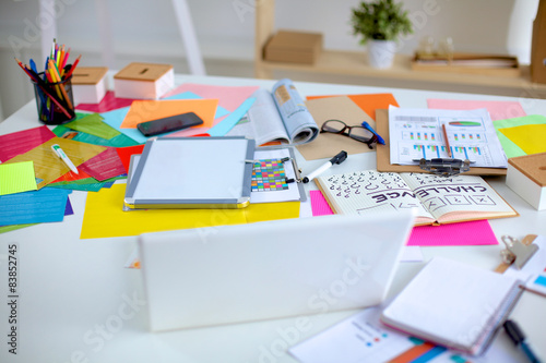 Fotografie, Obraz  Designer's table with notes and tools