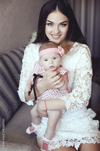 Fotobehang womenART beautiful mother with luxurious dark hair and her little baby