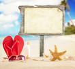 Summer beach with blank wooden poster