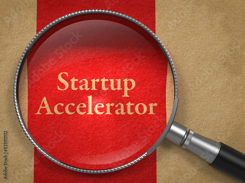 Startup Accelerator through Magnifying Glass. Canvas Print