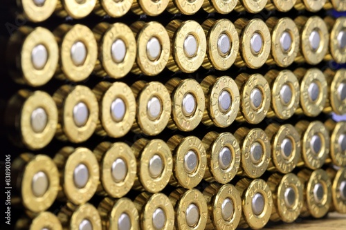 Photo A row of 45 caliber ammunition copper plated bullets