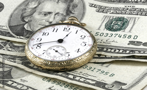 Fotografía Time and Money concept image with watch and cash