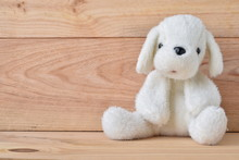 Plush Dog Toy With Wooden Background
